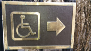 Accessibility sign in brass